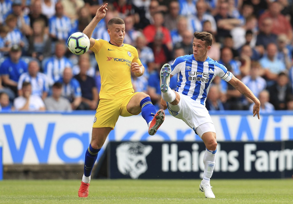 Chelsea's Ross Barkley, left, and Huddersfield Town's Jonathan Hogg in action during their English Premier League soccer match at the John Smith's Sta