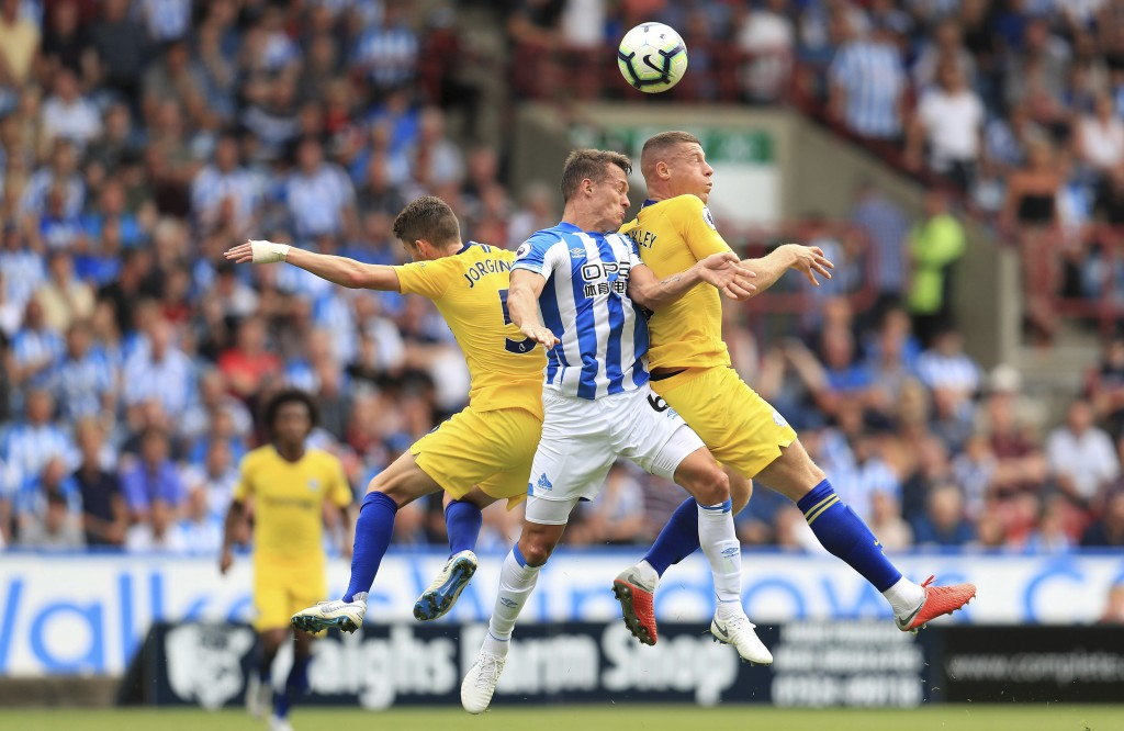 Huddersfield Town's Jonathan Hogg, centre, battles with Chelsea's Jorginho, left, and Ross Barkley during their English Premier League soccer match at