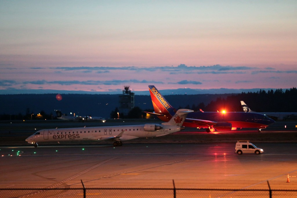 Planes sit on the tarmac at Sea-Tac International Airport after service was halted after an Alaska Airlines plane was stolen Friday, Aug. 10, 2018, in...