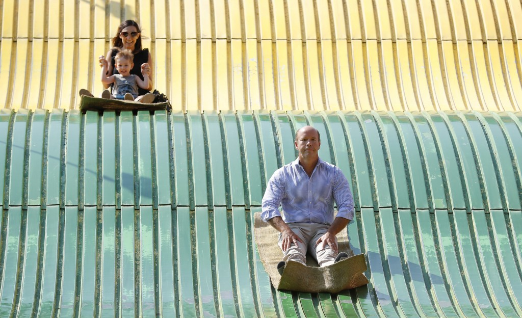 Rep. John Delaney, D-Md., rides down the giant slide during a visit to the Iowa State Fair, Friday, Aug. 10, 2018, in Des Moines, Iowa. (AP Photo/Char...