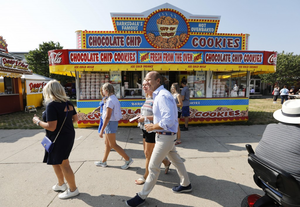 Rep. John Delaney, D-Md., walks past a concession stand during a visit to the Iowa State Fair, Friday, Aug. 10, 2018, in Des Moines, Iowa. (AP Photo/C