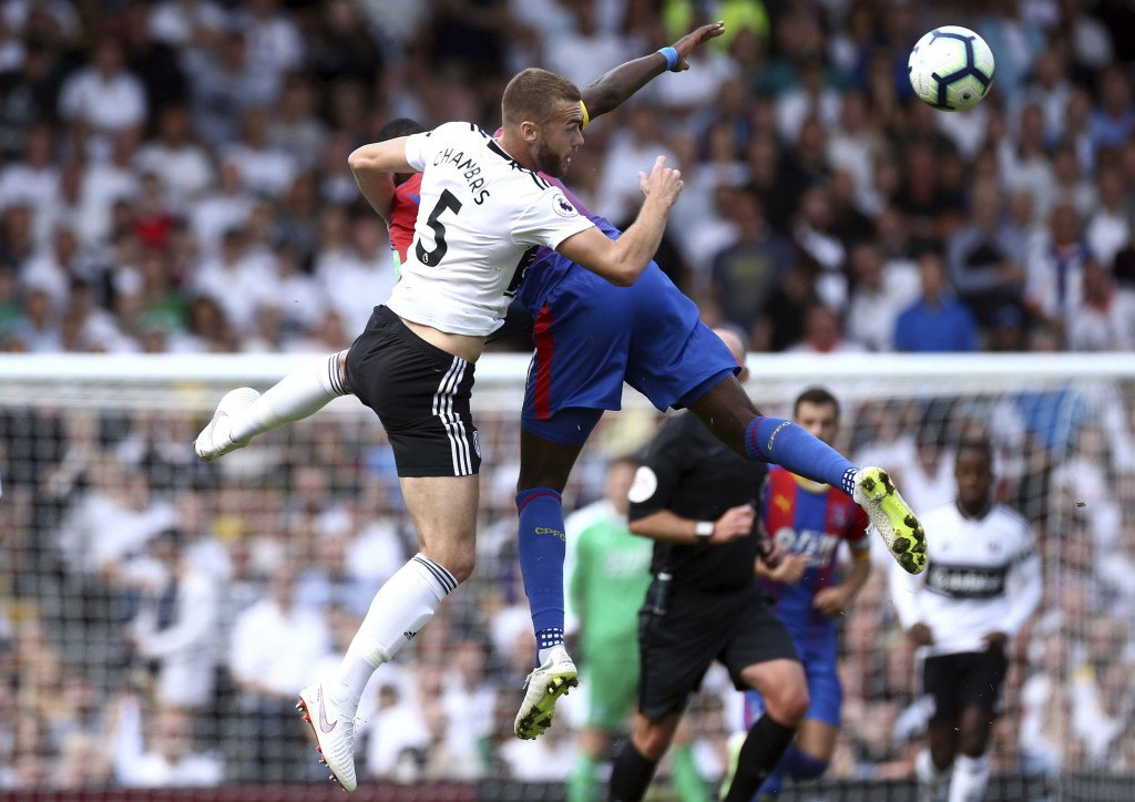 Fulham's Calum Chambers, left, and Crystal Palace's Max Meyer in action during their English Premier League soccer match at Craven Cottage in London,