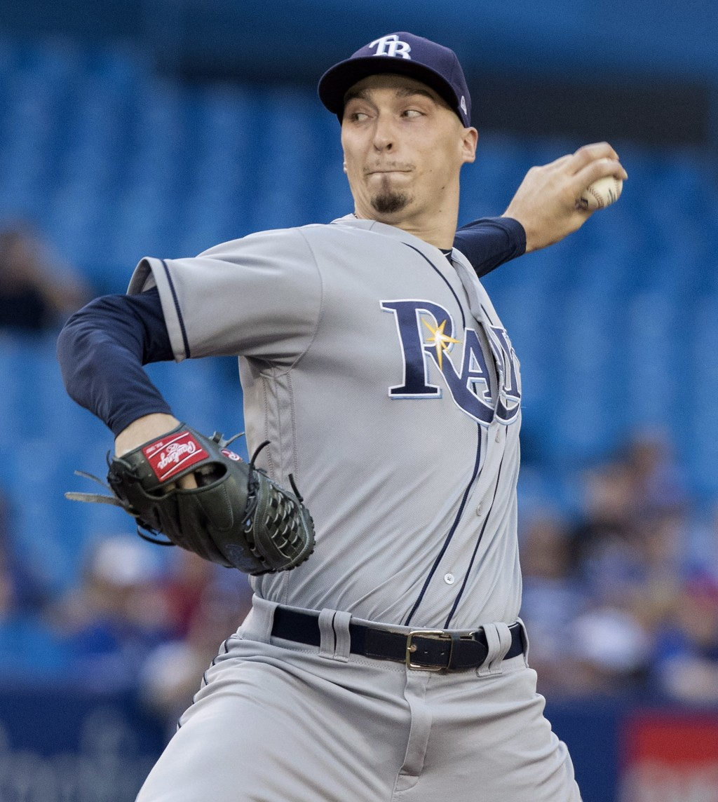 Tampa Bay Rays starting pitcher Blake Snell throws to a Toronto Blue Jays batter during the first inning of a baseball game Friday, Aug. 10, 2018, in