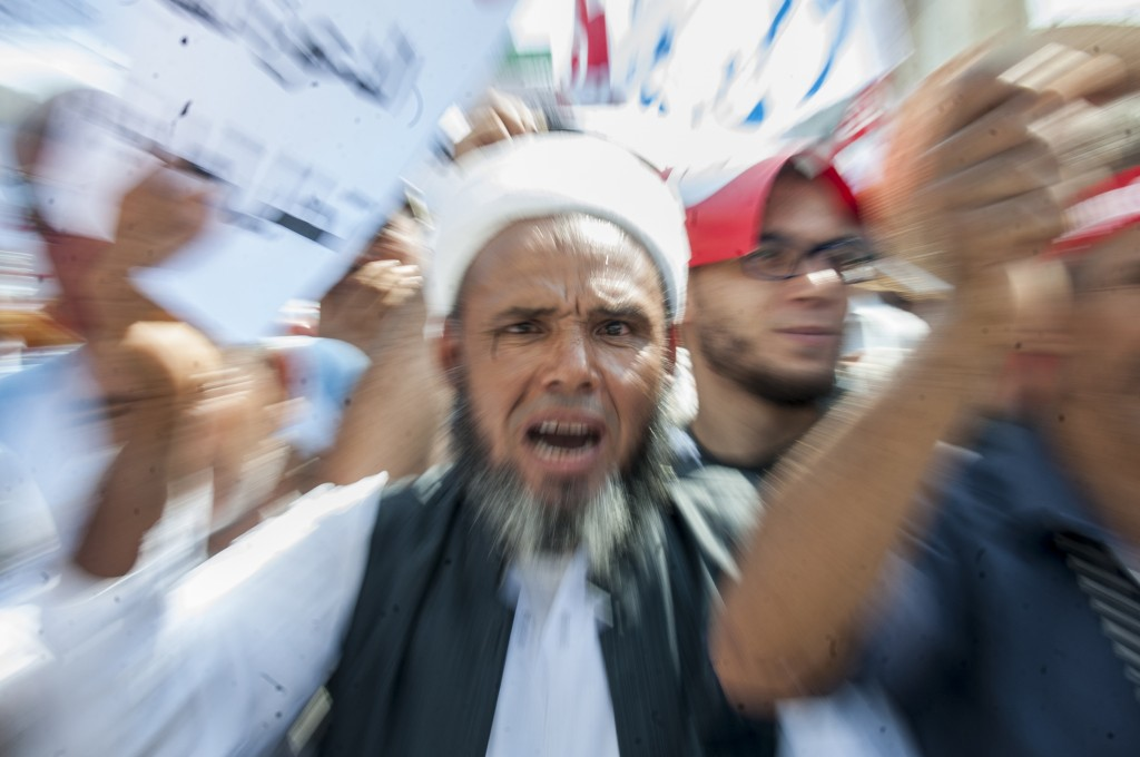 A man shouts during a demonstration in Tunis, Saturday Aug 11, 2018. Thousands of Muslim fundamentalists have held an hours-long protest in front of t
