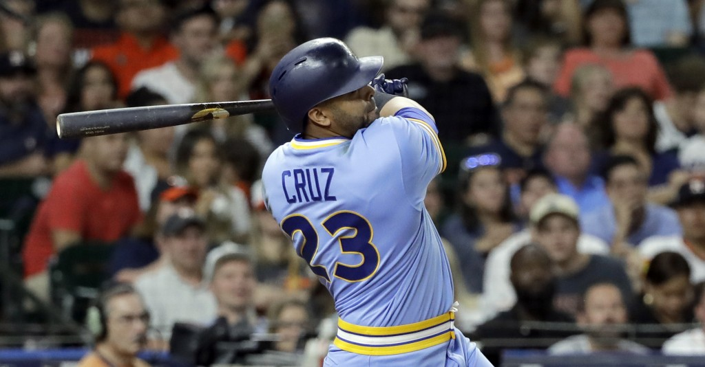 Seattle Mariners' Nelson Cruz watches a two-run double against the Houston Astros during the eighth inning of a baseball game Friday, Aug. 10, 2018, i