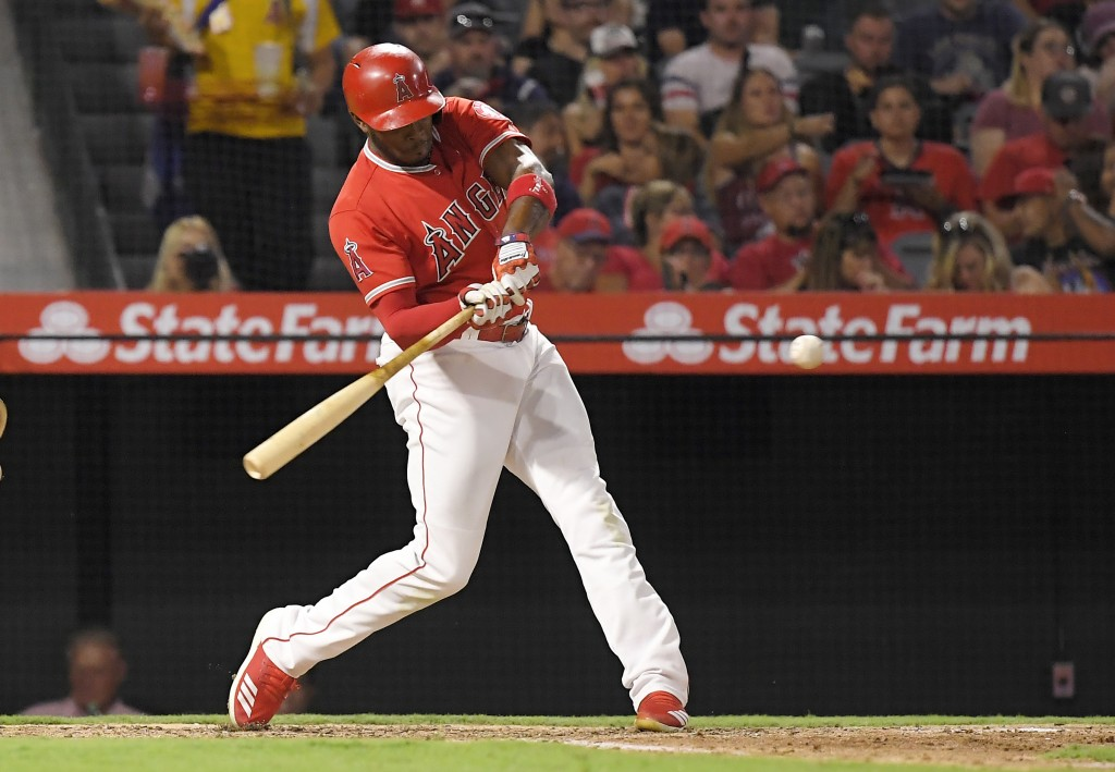 Los Angeles Angels' Justin Upton hits a two-run home run during the sixth inning of against the Oakland Athletics in a baseball game Friday, Aug. 10,