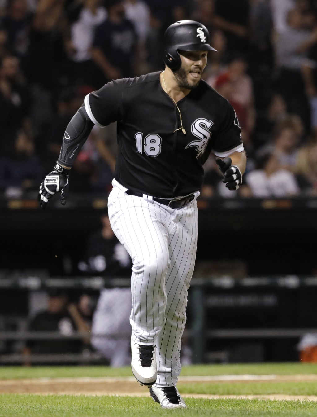 Chicago White Sox's Daniel Palka rounds the bases after hitting a home run against the Cleveland Indians during the ninth inning of a baseball game Fr