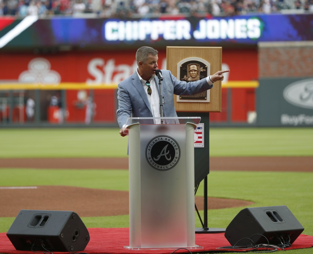Former Atlanta Braves third baseman and Baseball Hall of Fame member Chipper Jones waves the the crowd as he speaks during a ceremony before a basebal