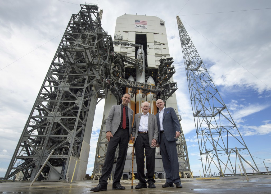 CORRECTS SPELLING TO TORY, NOT TONY - In this photo provided by NASA, astrophysicist Eugene Parker, center, stands with NASA Associate Administrator f