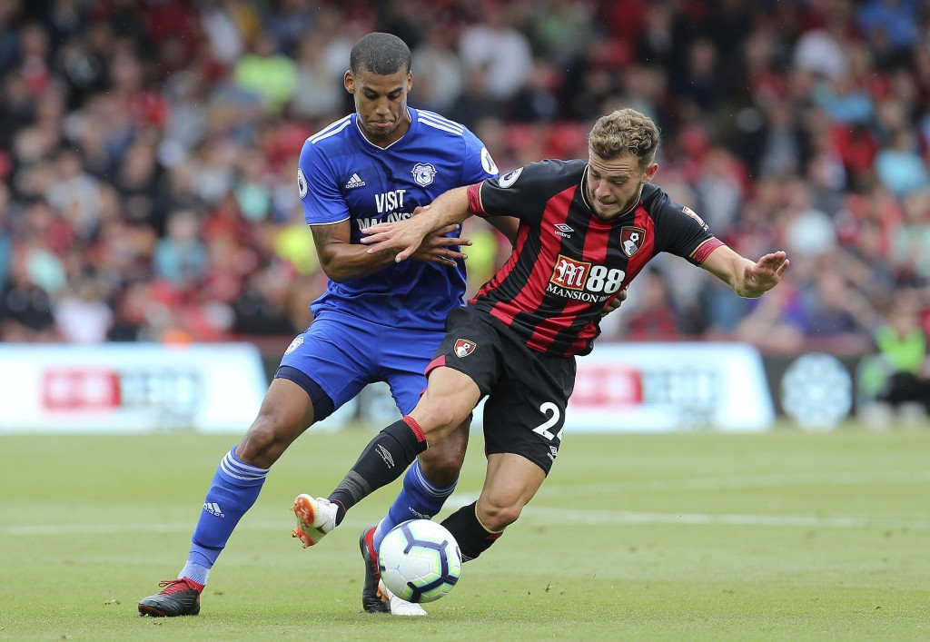 Cardiff City's Lee Peltier, left, and Bournemouth's Ryan Fraser in action during their English Premier League soccer match at the Vitality Stadium in