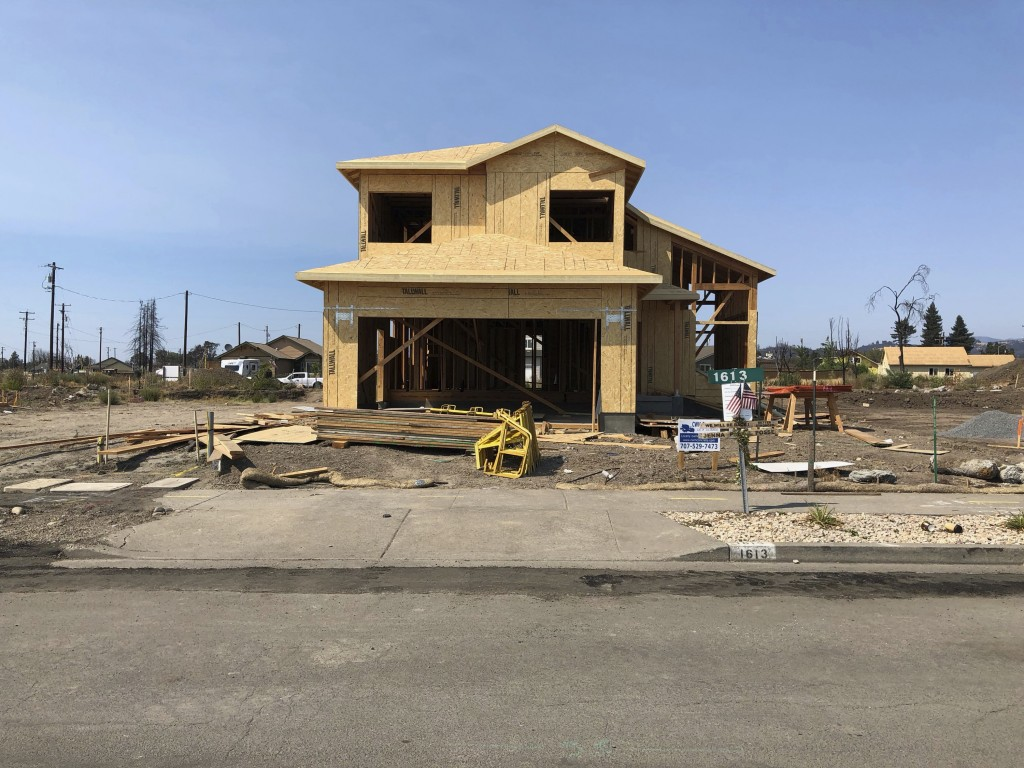 In this Friday, August 10, 2018, photo the partially rebuilt home of Debbie and Rick Serdin in the Coffey Park neighborhood in Santa Rosa, Calif. The