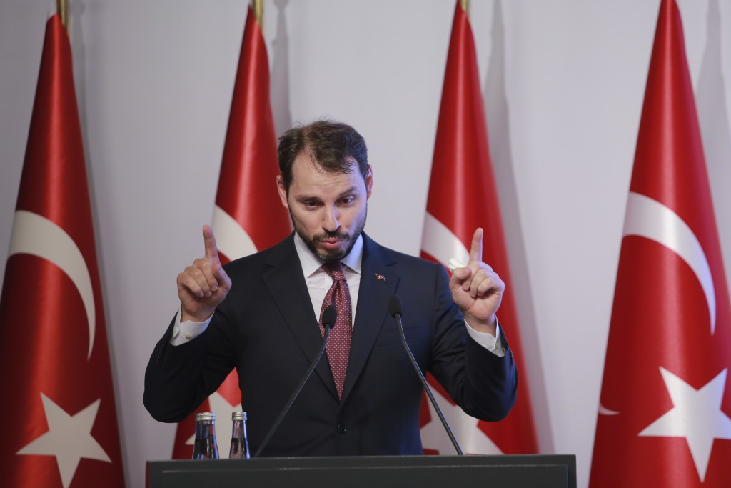 Berat Albayrak, Turkey's Treasury and Finance Minister, gestures as he talks during a conference in Istanbul, Friday, Aug. 10, 2018, in a bid to ease ...