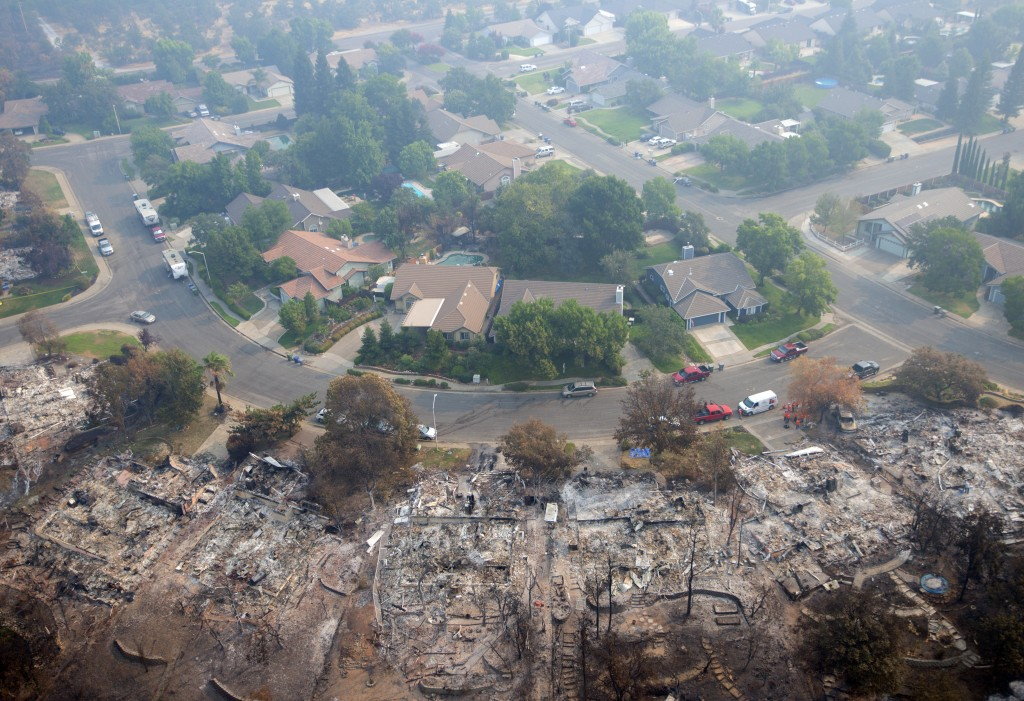 Homes destroyed by a wildfire are seen from an aerial view in the Keswick neighborhood of Redding, Calif., Friday, Aug. 10, 2018. Fire crews have made