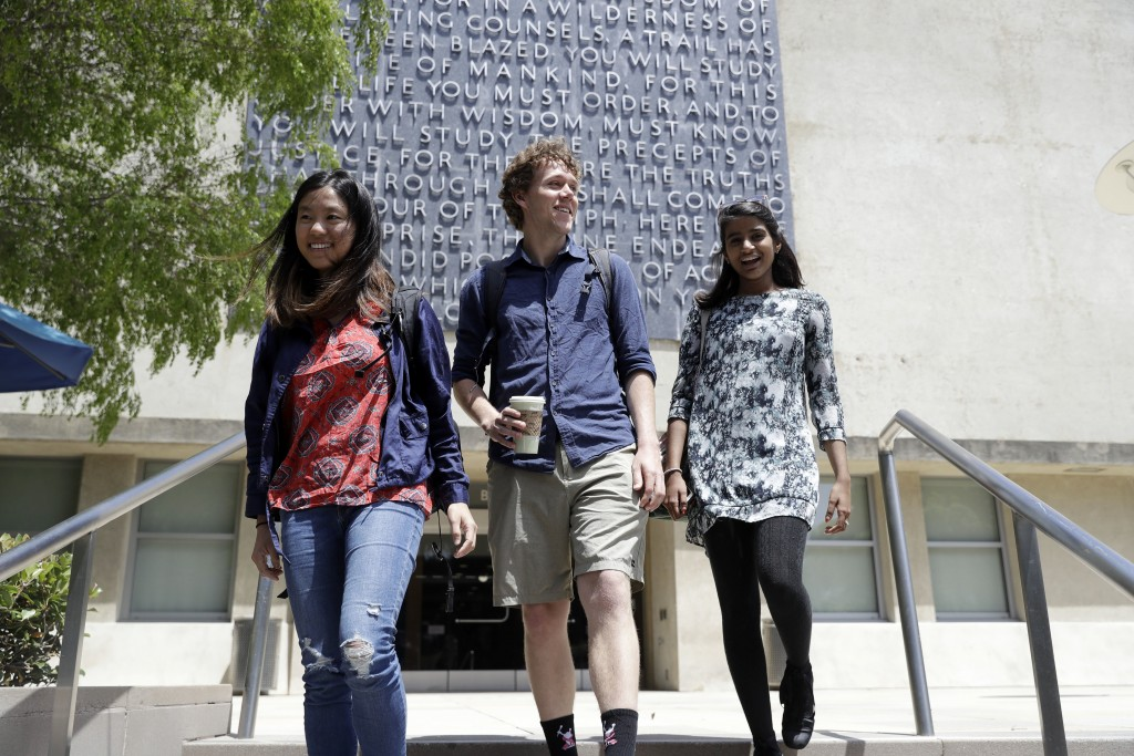 University of California students, from left, Alice Ma,Tyler Heintz and Anjali Banerjee walk near the university's campus Wednesday, June 6, 2018, in,