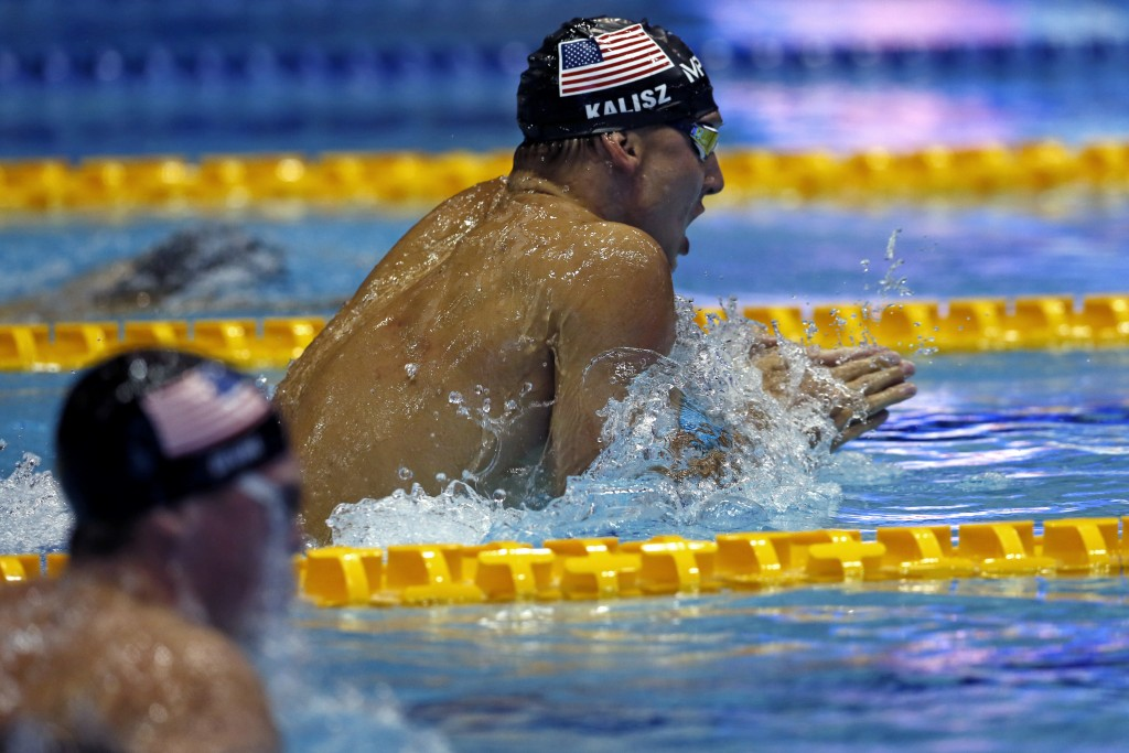 U.S. swimmer Chase Kalisz, center, competes on his way to winning the men's 200m individual medley final during the Pan Pacific swimming championships