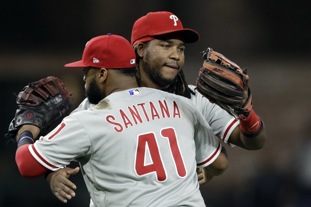 Philadelphia Phillies third baseman Maikel Franco, rear, celebrates with first baseman Carlos Santana after the Phillies defeated the San Diego Padres