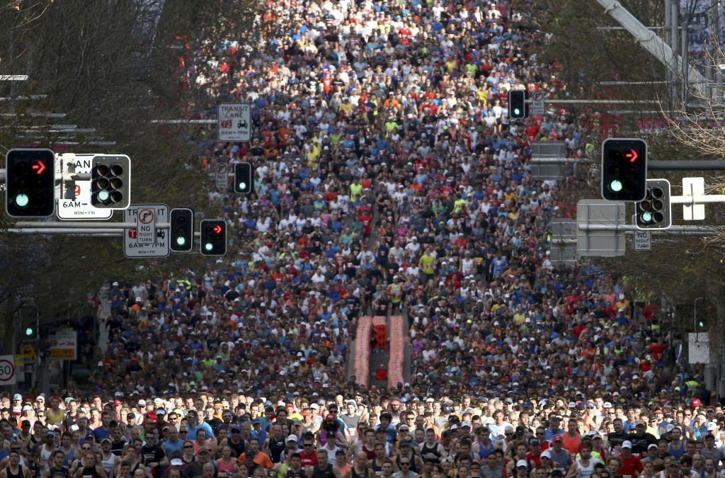 In this Sunday, Aug. 12, 2018, photo,  some of the 80,000 participants in the annual City2surf fun run make their way along the 14km (8.7 miles) cours...