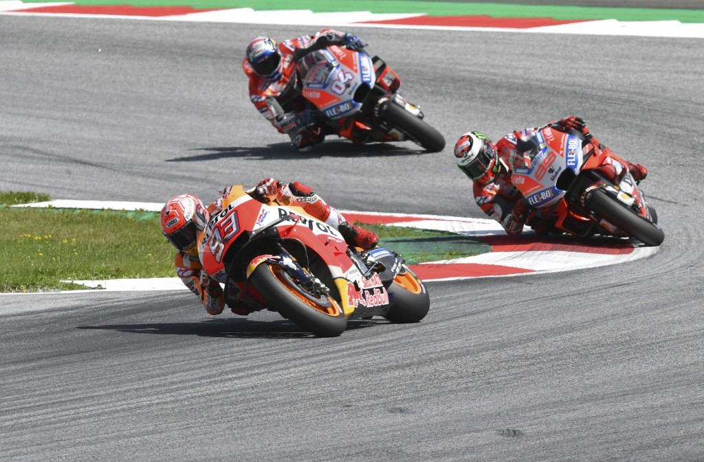 Spain's rider Marc Marquez of the Repsol Honda Team, front, steers his motorcycle followed by Spain's rider Jorge Lorenzo of the Ducati Team and Itali