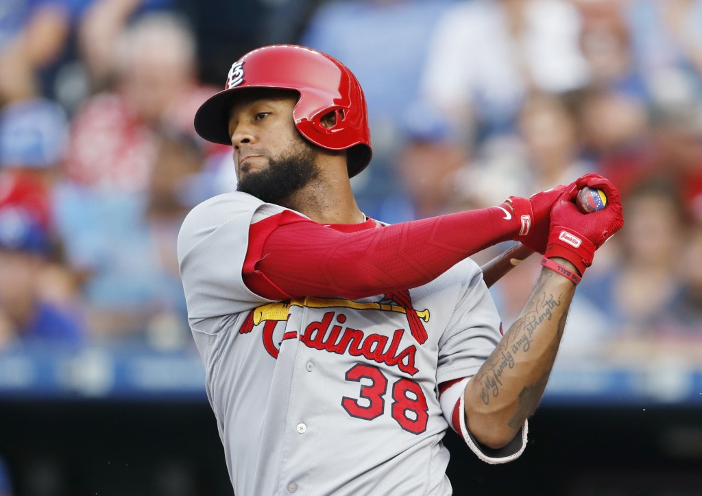 St. Louis Cardinals' Jose Martinez hits an RBI-single in the third inning of a baseball game against the Kansas City Royals at Kauffman Stadium in Kan