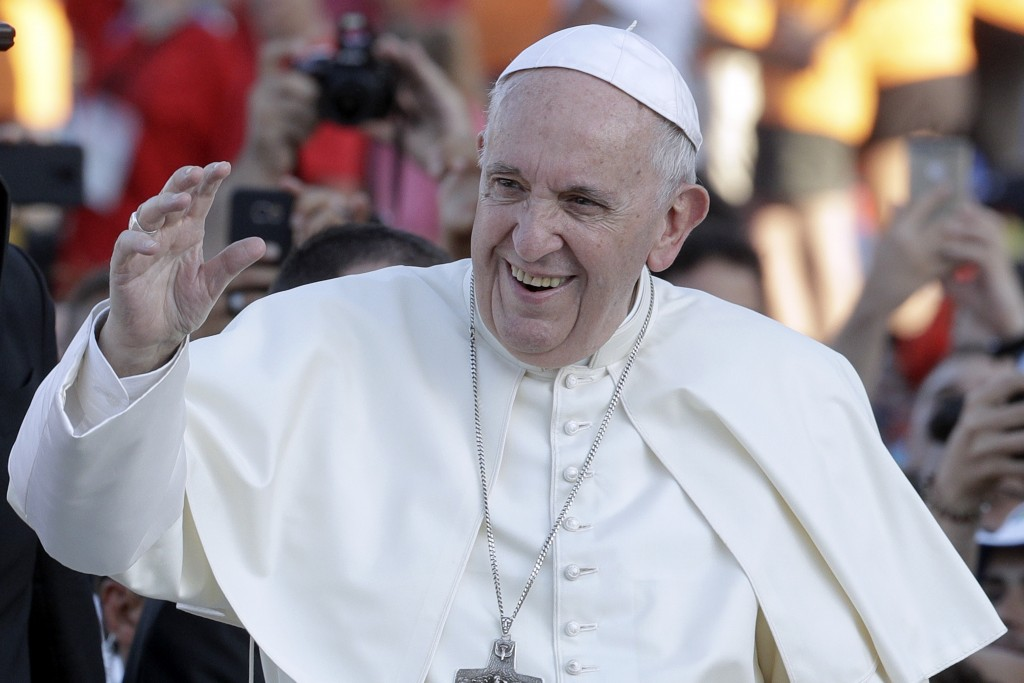 Pope Francis arrives at Rome's Circus Maximus to lead an evening prayer vigil with youths, Saturday, Aug. 11, 2018. Thousand of youths gathered for th...