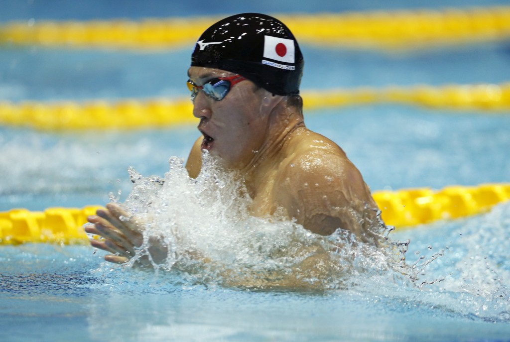 Japan's Ippei Watanabe swims on his way to winning the men's 200m breaststroke final during the Pan Pacific swimming championships in Tokyo, Sunday, A