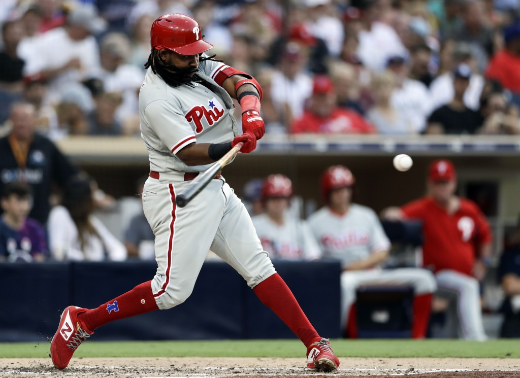 The Philadelphia Phillies' Maikel Franco hits a home run during the fourth inning of a baseball game against the San Diego Padres, Saturday, Aug. 11,