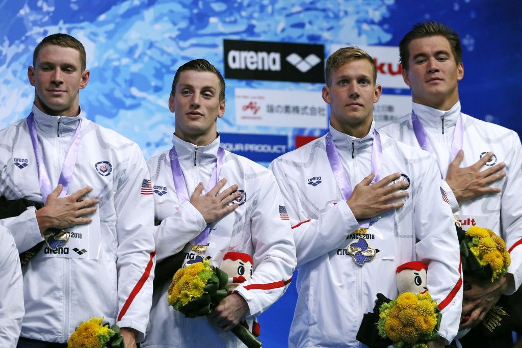 U.S. team members, from left to right, Ryan Murphy, Andrew Wilson, Caeleb Dressel, and Nathan Adrian, celebrate on the podium after winning the men's