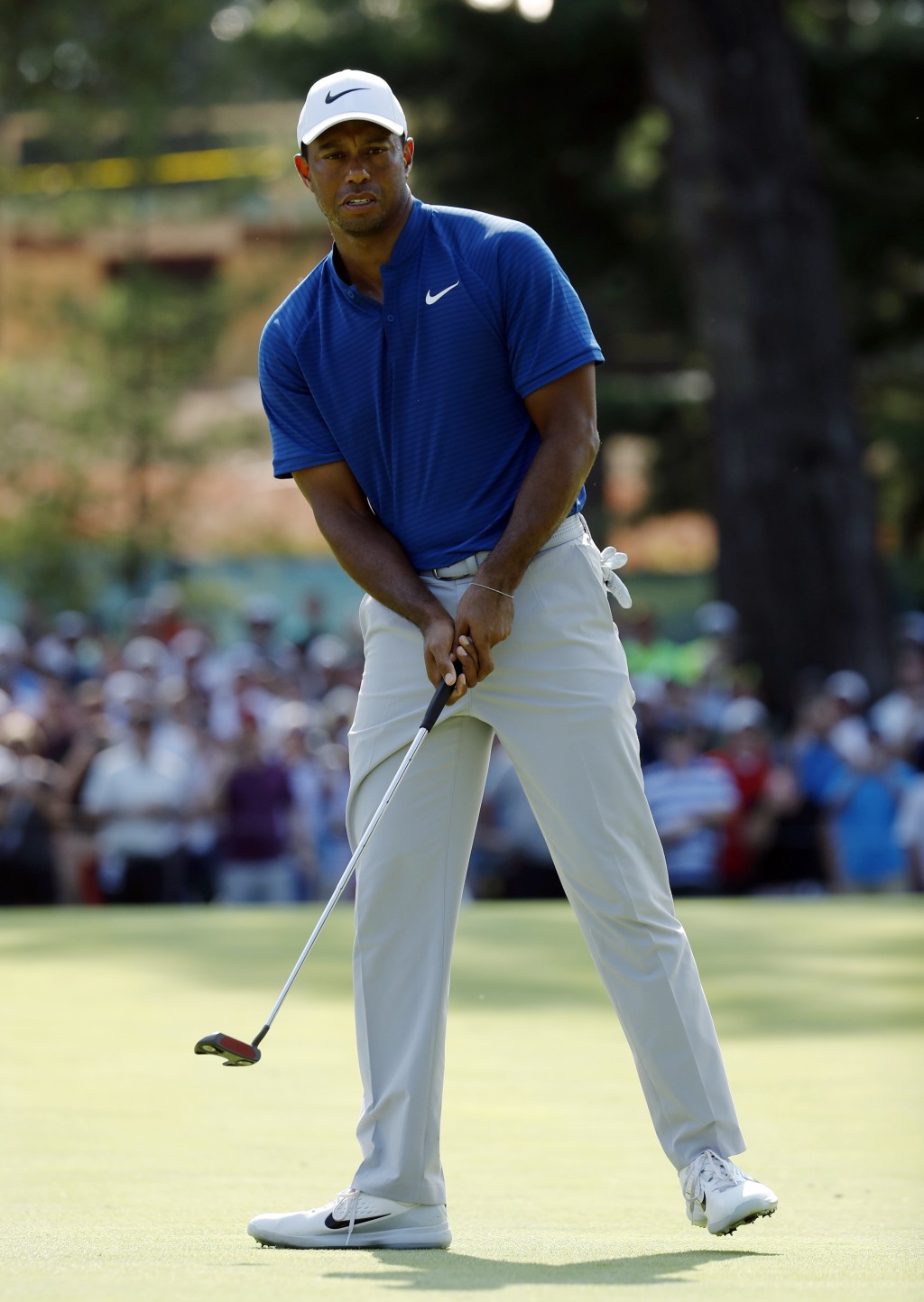 Tiger Woods looks at his putt on the 15th green during the third round of the PGA Championship golf tournament at Bellerive Country Club, Saturday, Au