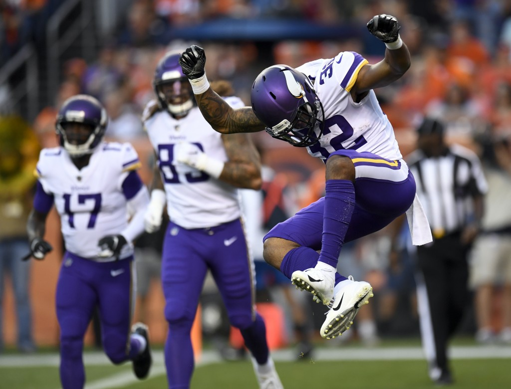 Minnesota Vikings running back Roc Thomas celebrates after scoring against the Denver Broncos during the first half of an NFL football preseason game