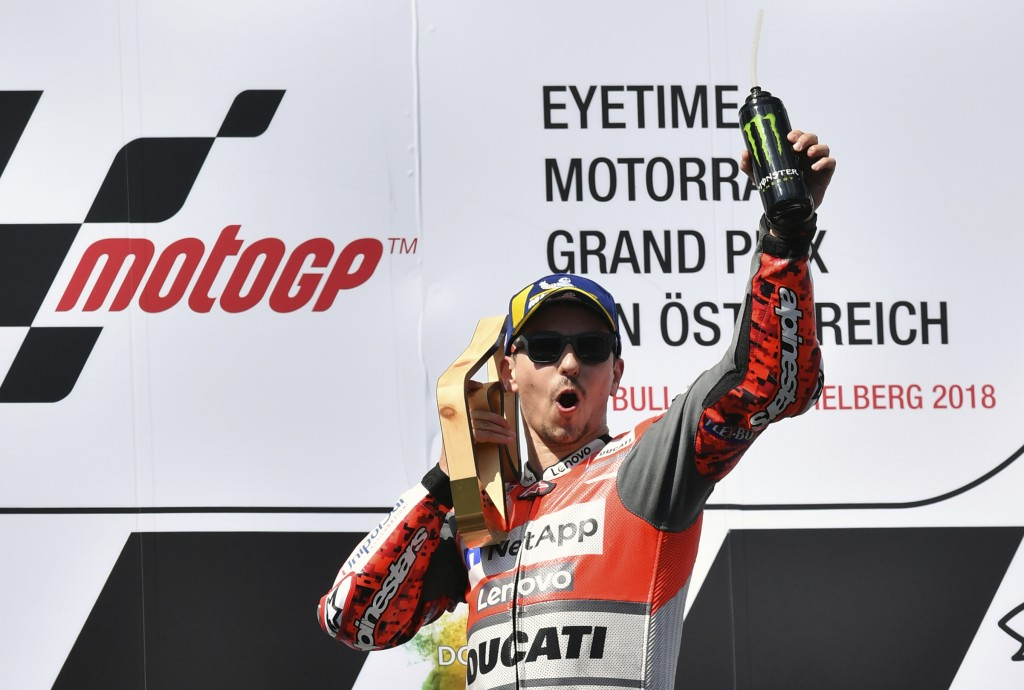 Spain's rider Jorge Lorenzo of the Ducati Team celebrates on the podium after winning the MotoGP race at the Austrian motorcycle Grand Prix at the Red