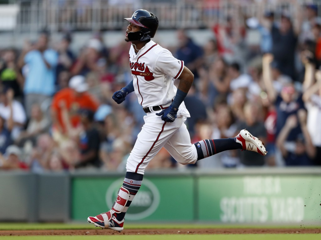 Atlanta Braves' Ronald Acuna Jr. (13) rounds the base after hitting a solo-home run in the first inning of a baseball game against the Milwaukee Brewe