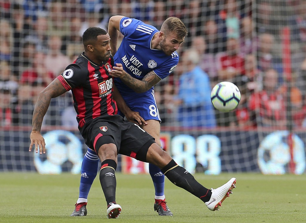 Bournemouth's Callum Wilson, left, and Cardiff City's Joe Ralls during their English Premier League soccer match at the Vitality Stadium in Bournemout