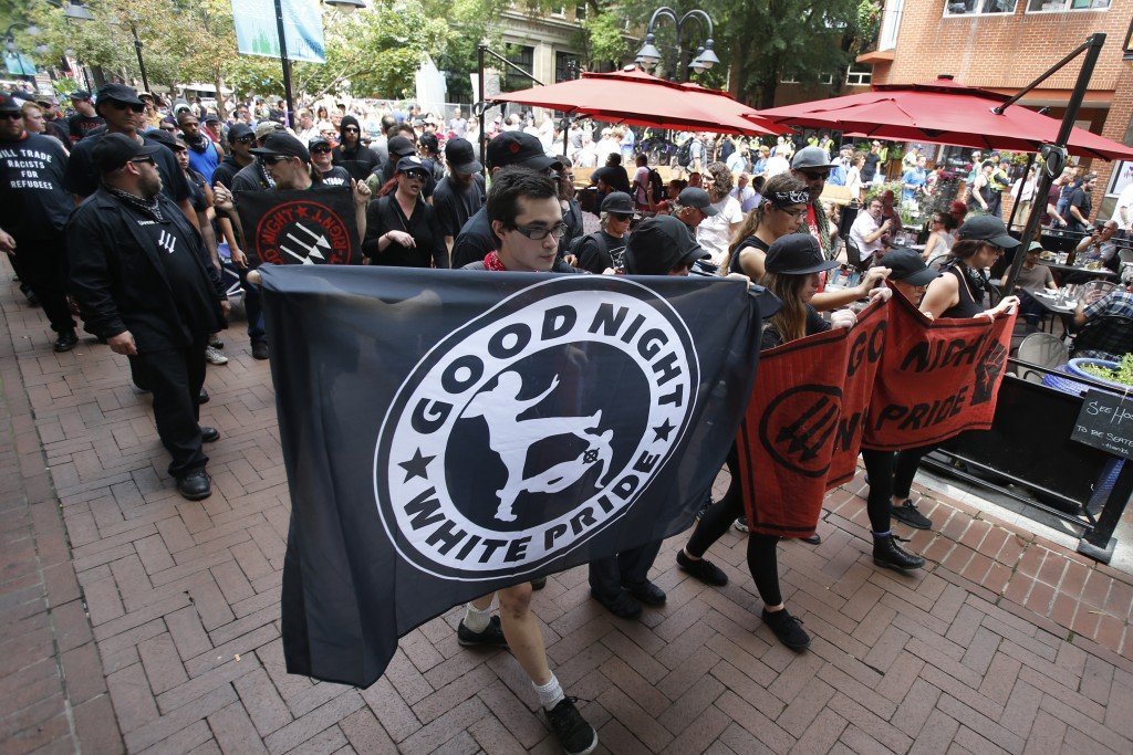 A group anti-fascism demonstrators march in the downtown area in anticipation of the anniversary of last year's Unite the Right rally in Charlottesvil