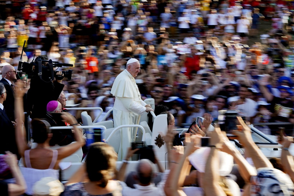 Pope Francis arrives at Rome's Circus Maximus to lead an evening prayer vigil with youths, Saturday, Aug. 11, 2018. Thousand of youths gathered for th