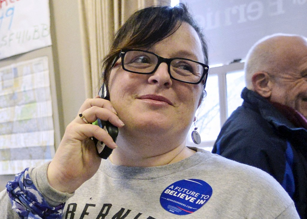 FILE - In this Feb. 8, 2016, file photo, Brenda Siegel, of Newfane, Vt., helps train volunteers to make phone calls for Democratic presidential candid
