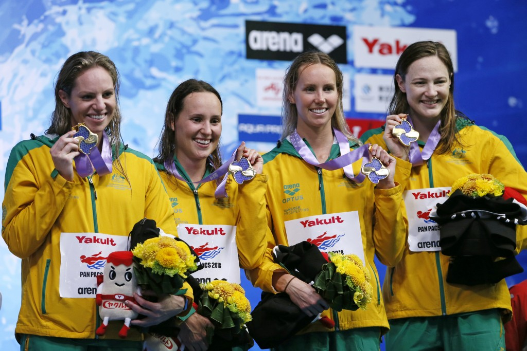 Australia's team members, from left to right, Emily Seebohm, Jessica Hansen, Emma McKeon, and Cate Campbell, celebrate on the podium after winning the