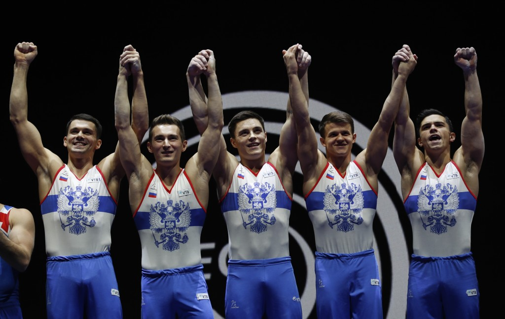 Members of the Russian team hold up their gold medals after placing first in the men's artistic gymnastics team finals at the European Championships i...