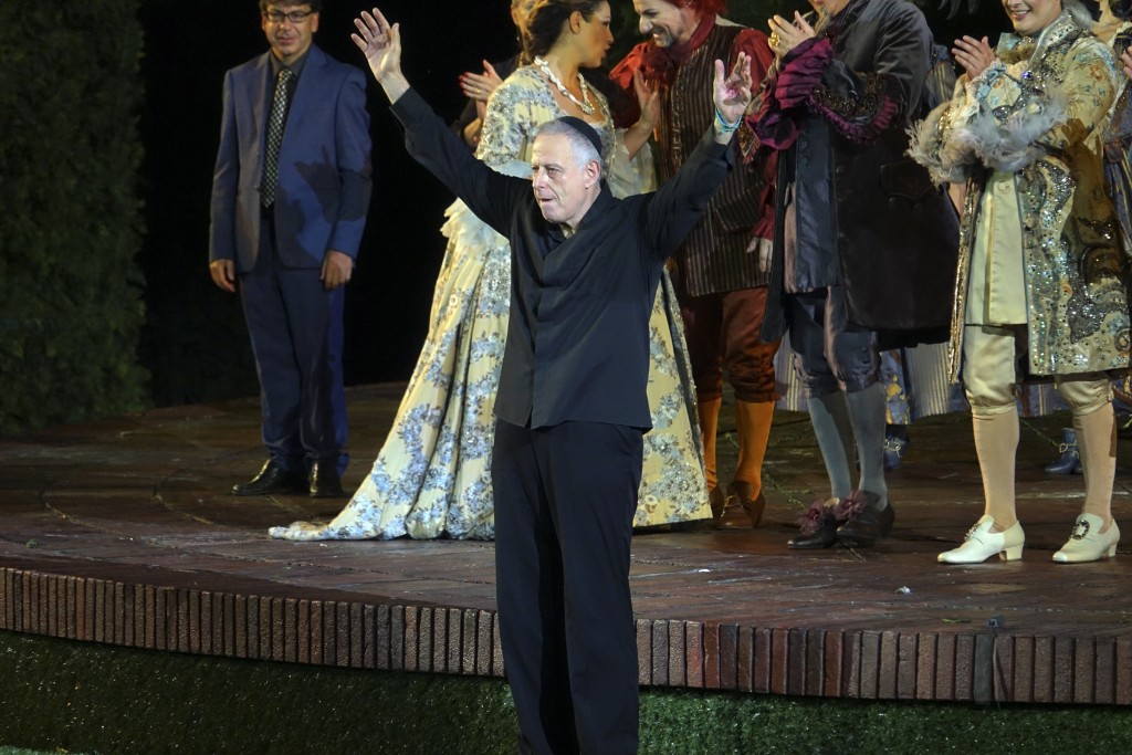 Israeli conductor Daniel Oren acknowledges the crowd at the end of Rossini's ''Barbiere di Siviglia'' at the Verona Arena, in Verona, Northern Italy,