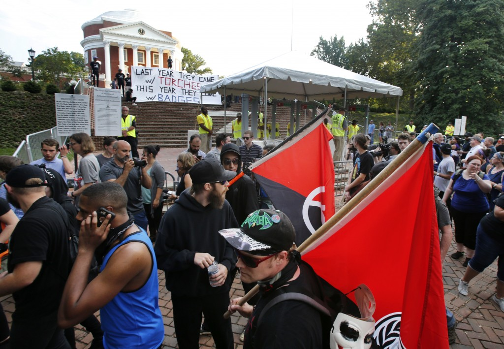 A group of anti-fascist and Black Lives Matter demonstrators march in front of the Rotunda on the campus of the University of Virginia in anticipation
