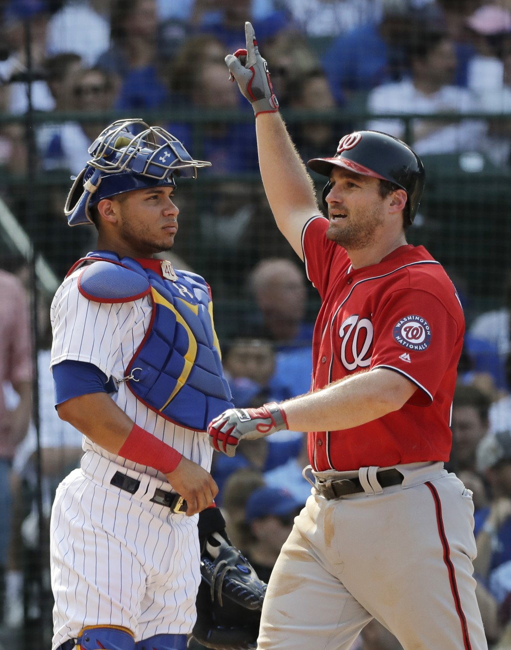 Washington Nationals' Daniel Murphy, right, celebrates after hitting a two-run home run as Chicago Cubs catcher Willson Contreras looks to the field d
