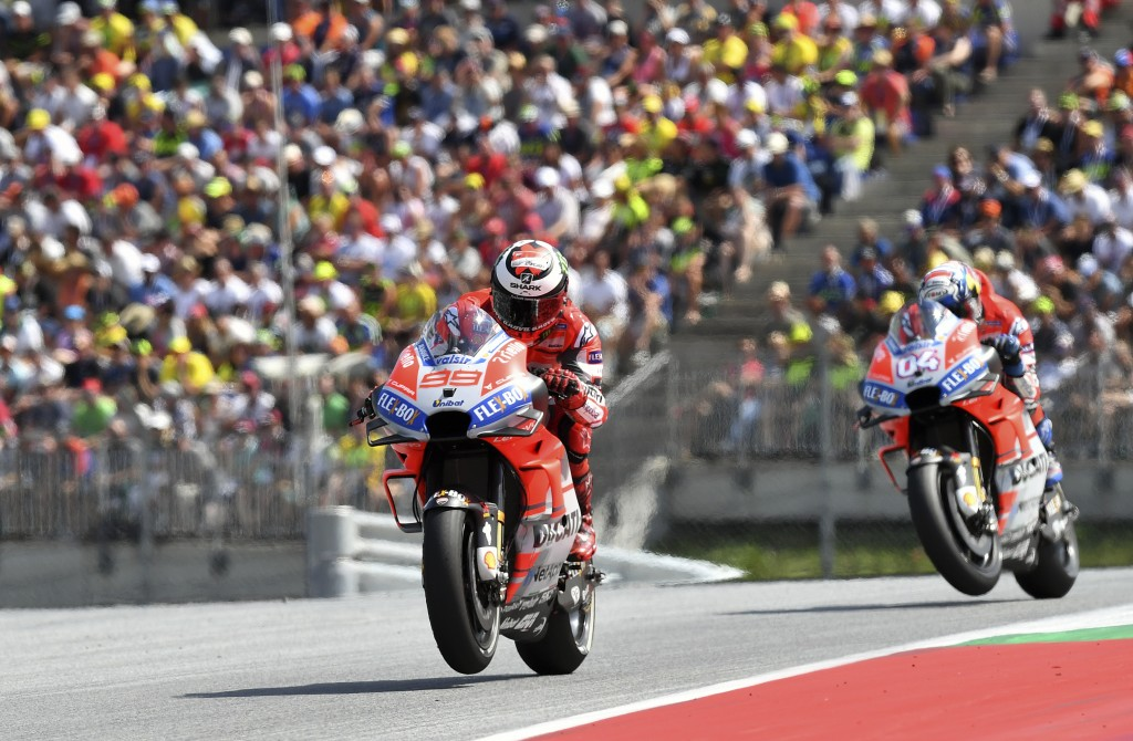 Spain's rider Jorge Lorenzo of the Ducati Team steers his motorcycle followed by Spain's rider Marc Marquez of the Repsol Honda Team during the MotoGP