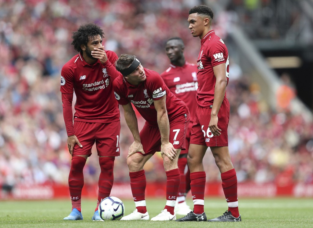 Liverpool's Mohamed Salah, left, James Milner, centre, and Trent Alexander-Arnold discuss a free-kick during the Premier League soccer match between L