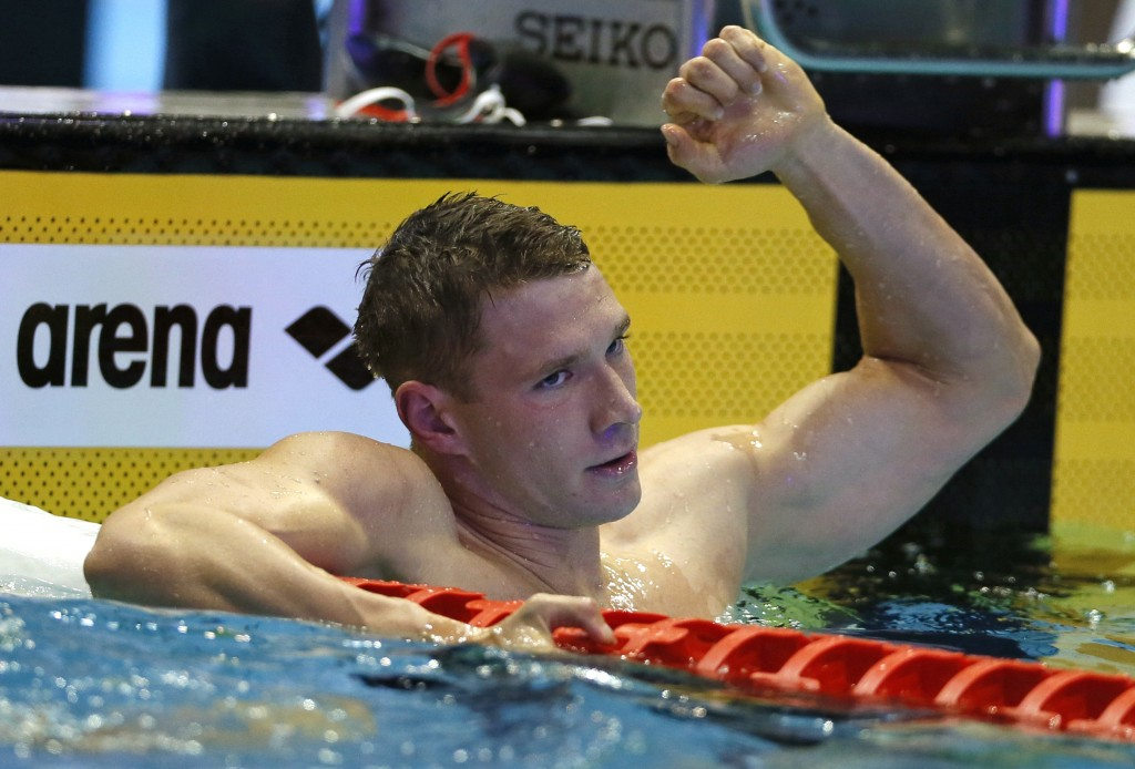 Ryan Murphy of the U.S., reacts after winning the men's 200m backstroke final during the Pan Pacific swimming championships in Tokyo, Sunday, Aug. 12,