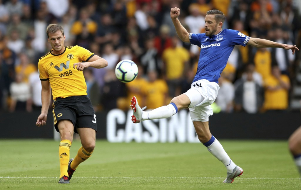 Wolverhampton Wanderers' Ryan Bennett, left, and Everton's Gylfi Sigurdsson during their English Premier League soccer match at Molineux in Wolverhamp