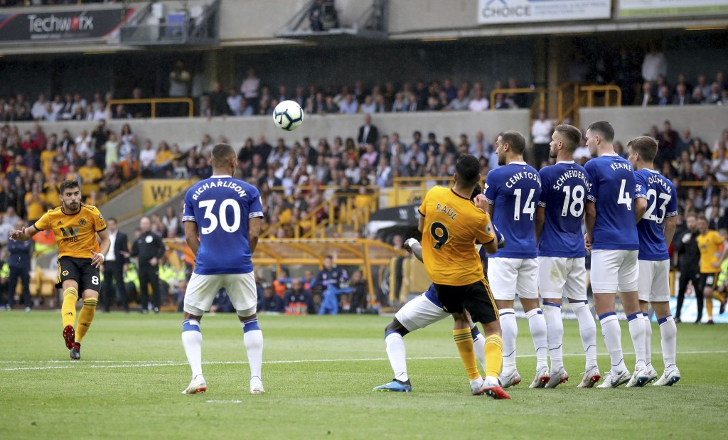 Wolverhampton Wanderers' Ruben Neves (left) scores his side's first goal of the game against Everton during their English Premier League soccer match