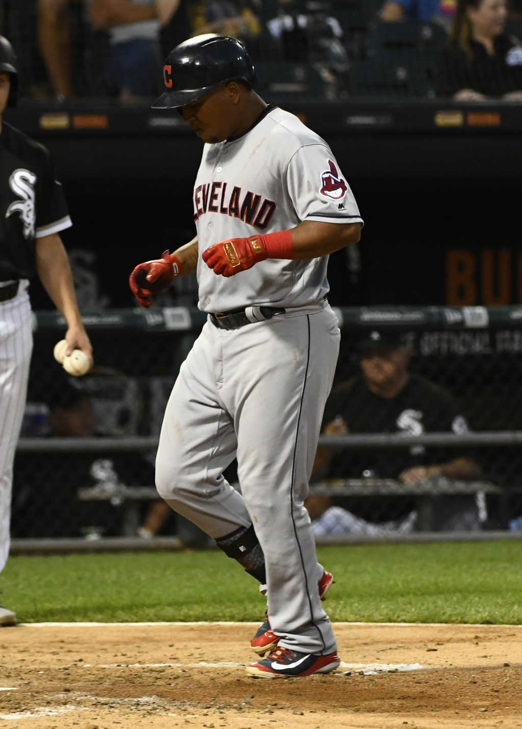 Cleveland Indians' Jose Ramirez crosses home plate after his home run against the Chicago White Sox during the sixth inning of a baseball game on Satu
