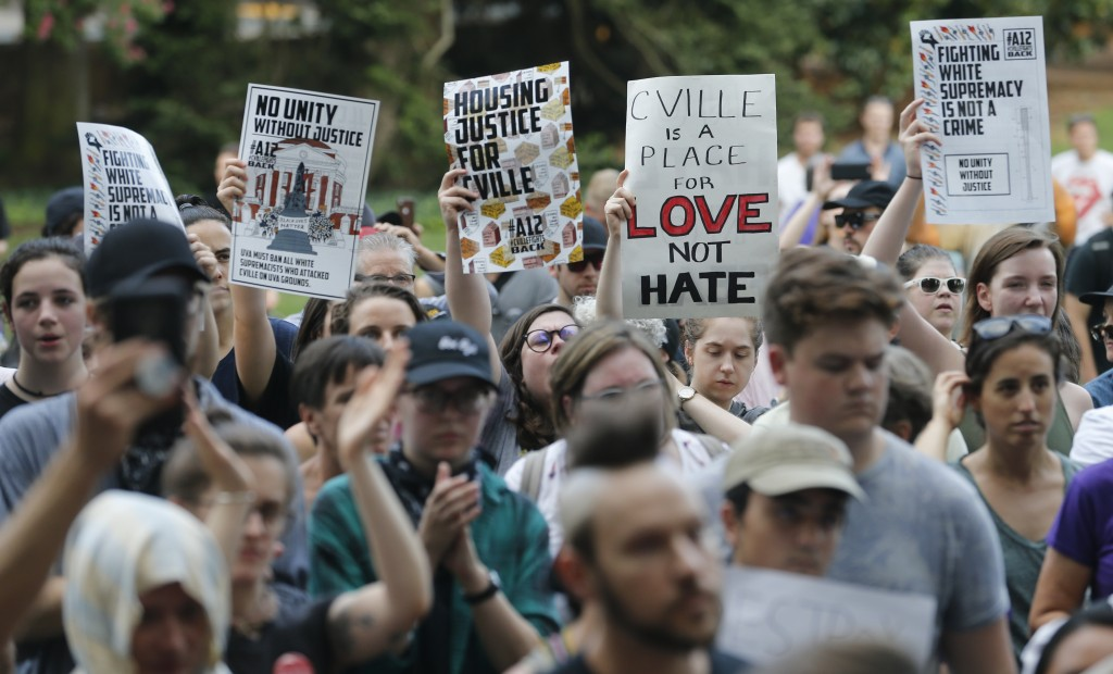 Demonstrators march on the campus of the University of Virginia in anticipation of the anniversary of last year's Unite the Right rally in Charlottesv