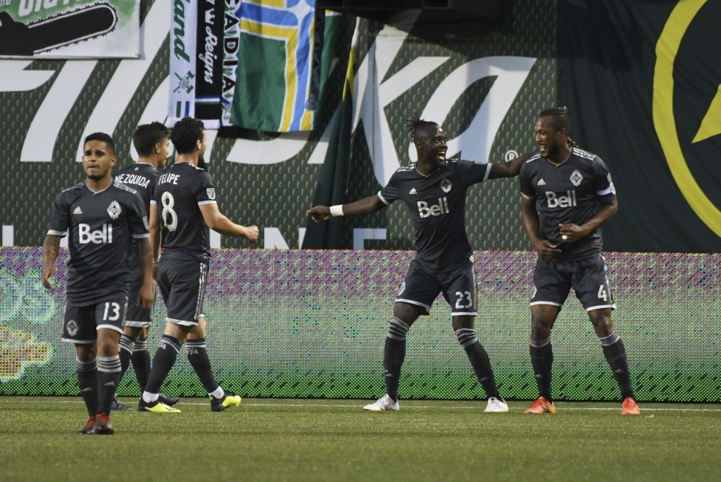 Vancouver Whitecaps players celebrate a goal by Kei Kamara (23) against the Portland Timbers during an MLS soccer match Saturday, Aug. 11, 2018, in Po