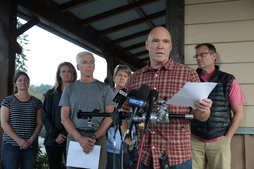 Mike Mathews and friends of Richard Russell talk to the media Saturday, Aug. 11, 2018, at the Orting Valley Police and Fire Department, in Orting, Was