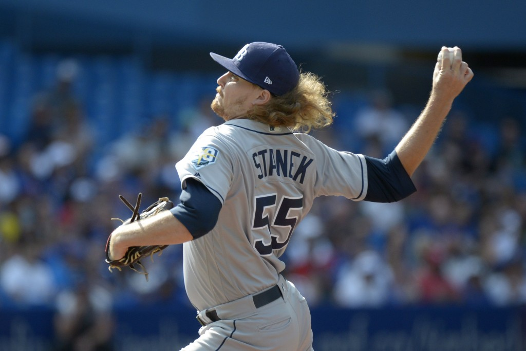 Tampa Bay Rays starting pitcher Ryne Stanek throws against the Toronto Blue Jays during the first inning of a baseball game in Toronto, Saturday, Aug.